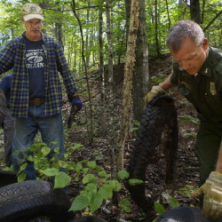 Volunteers clean up dumped trash on private lands used by public
