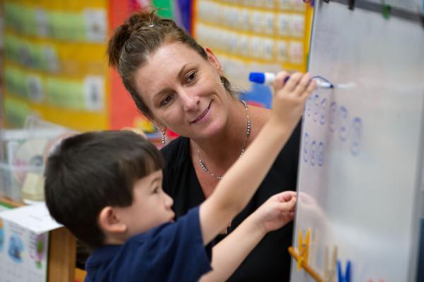 Kindergarten teacher Terri Lowe with student Tristan Kobayashi at Foulks Ranch Elementary School in Elk Grove, California, on Aug. 28, 2012.