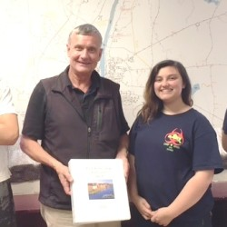 Augusta Boys and Girls Club members Salemn Chapman, Samantha Chase and Kaleb Brann  present report to Leif Dahlin.