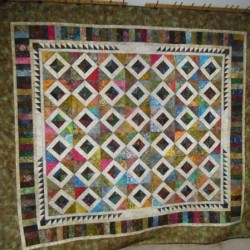 "Quilt - Tropical Visions, approximately 82"" x 92"", designed, stitched and machine-quilted by Sandra L. Hatch."