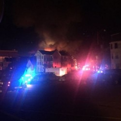 Firefighters battled a fire on Oak Street fire in Lewiston on Sunday night into Monday morning.