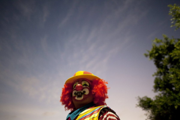 A clown is seen during celebrations on the International Day of the Clown in Cancun in this December 2012 file photo.