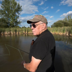 Bill Braniff a 71-year-old Vietnam War veteran tries fly fishing for the first time on a small pond on the grounds of the Dorothea Dix Psychiatric Center in Bangor. Project Healing Waters teaches veterans how to fish and takes them on trips to enjoy the outdoors.