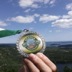 Mass. man sets course record in Maine Marathon