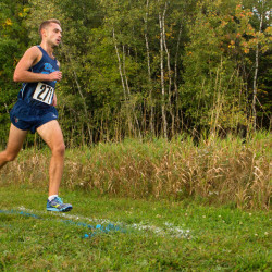 University of Maine's Jesse Orach runs during their cross-country meet in Orono on Friday. Orach won the men's race.