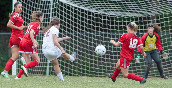 Edward Little's Piper Norcross takes a shot on Camden Hills' goalie Isabelle Lang, right, during the first half of Friday's game in Auburn. The shot sailed just over the net, resulting in a goal kick for Camden Hills.