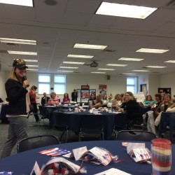 "Adria Horn, director of the Maine Bureau of Veterans Services, put on a decorated veteran's baseball hat, that many male veterans wear, at the Maine Women Veterans event on Saturday and said, ""We don't do this,"" about the headwear. ""What that means is we need to find something else."" She then advocated for female veterans to let others know they have served, suggesting the veteran license plate or other displays."