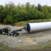A 14-foot diameter, 60-ton base of a Vestas V90-1.8 megawatt wind turbine is hauled up the access road to the Pisgah Mountain wind farm site in Clifton Friday morning. This is the first of 45 pieces that will be trucked from the port in Searsport to the site in Clifton over three weeks. Developer Paul Fuller said that the five turbines need to be in place before Oct. 15 to meet a deadline required as part of the Public Utility Commission's 20-year Community-based Renewable Energy contract between Pisgah and Emera Maine. Each turbine has a hub height of 305 feet and each blade is 140 feet long. A 351-foot crane was brought in to install them on the mountain. This $25 million wind farm project was unanimously approved by the Clifton Planning Board back in October 2011.
