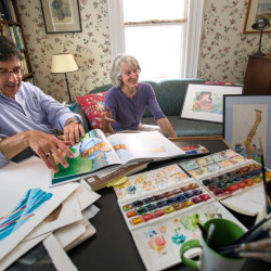 """Former BDN staffer Eric Zelz (left) and his wife Abigail talk about their collaboration on a children's book celebrating food and history called """"Pass The Pandowdy, Please: Chewing on History with Famous Folks and Their Fabulous Foods"""" at their home in Bangor."""