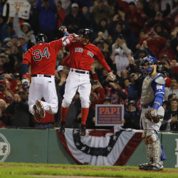 Boston Red Sox designated hitter David Ortiz (34) celebrates his two-run home run with right fielder Mookie Betts against the Toronto Blue Jays in the seventh inning at Fenway Park in Boston Friday night.