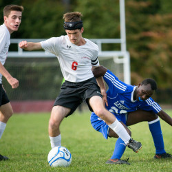 Camden Hills' Colby Arau (center) tries to break away from Lewiston's Sadiki Valens (right) while Camden Hills' Morgan Mercier looks on during their Class A North soccer game on Friday at Camden Hills Regional High School.
