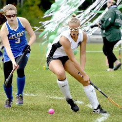 Leavitt Area High School's Allie Belaire, right, lines up a reverse stick shot as Belfast's Hannah Sanderson tries to catch up during their game in Turner on Saturday.