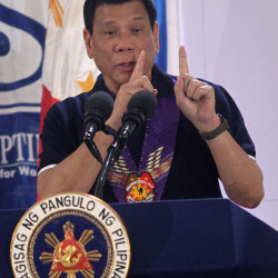 Philippines President Rodrigo Duterte gestures while delivering a speech before female police officers during a gathering in Davo City, Philippines, Sept. 30, 2016.
