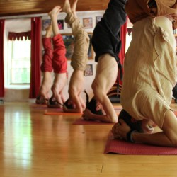 Students practice yoga at Hridaya Hermitage in Industry, Maine.