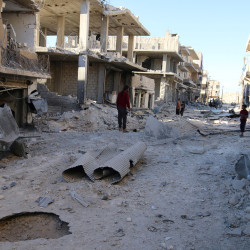 People inspect a damaged site after airstrikes on the rebel held Shieikh Fares neighborhood of Aleppo, Syria, Oct.1, 2016.