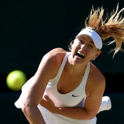 Maria Sharapova of Russia serves during her match against Serena Williams of the U.S.A. at the Wimbledon Tennis Championships in London, July 9, 2015.