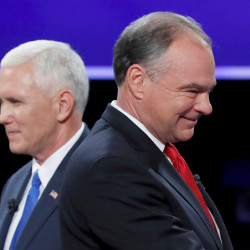 Democratic U.S. vice presidential nominee Sen. Tim Kaine and Republican U.S. vice presidential nominee Gov. Mike Pence (left) pass each other after the conclusion of their vice presidential debate at Longwood University in Farmville, Virginia, Oct. 4, 2016.