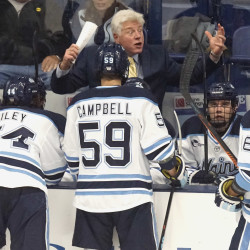 Maine hockey coach Red Gendron gets emphatic with his players during a break in the first period of their game against UMass Lowell in November 2015.