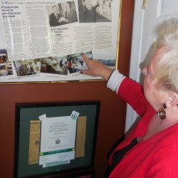 The walls of Patty LeBlanc's home office in Presque Isle are covered with memorabilia recognizing the success of one of the first businesses in Aroostook County to operate online.