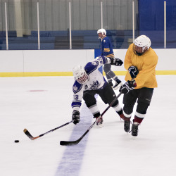 A group of older Mainers play ice hockey on Monday at the Midcoast Recreation Center in Rockport.