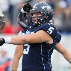 Pat Ricard of the University of Maine celebrates after registering a quarterback sack during the Black Bears' Sept. 1 win over Bryant. The senior is the linchpin of UMaine's defensive line.