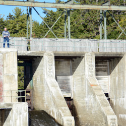Rick Hill (left) and Donald Dudley can be seen recently at Matagamon Dam in Township 6 Range 8. They hope to raise about $230,000 over the next several years to repair the dam.