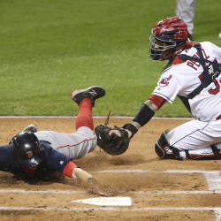 Cleveland Indians catcher Roberto Perez tags out the Boston's Brock Holt, left, at the plate in the first inning of Game 1 in the American League Division Series on Thursday night at Progressive Field in Cleveland.