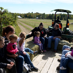 Visitors take a hayride on Sept. 29 at Treworgy Family Orchard in Levant.