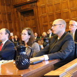 Gregory Nisbet (right) sits with his lawyers, Sarah Churchill (center) and Matthew Nichols, during closing arguments in Friday's manslaughter trial in Portland. Nisbet is accused of failing to maintain his Noyes Street property that burned down in 2014, killing six young adults. It was the state's most deadly fire in decades.