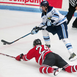 University of Maine's Brendan Robbins (right) moves the puck around an outstretched Rensselaer Polytechnic Institute's Will Reilly during their hockey game on Friday at Alfond Arena in Orono.