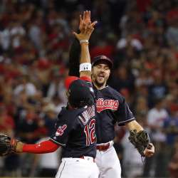 Cleveland Indians shortstop Francisco Lindor (left) and right fielder Lonnie Chisenhall (8) celebrate after defeating the Boston Red Sox during game two of their ALDS playoff series at Progressive Field in Cleveland on Friday. The Indians won 6-0.