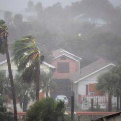 Rain batters homes as the eye of Hurricane Matthew passes Daytona Beach, Florida, Oct. 7, 2016.