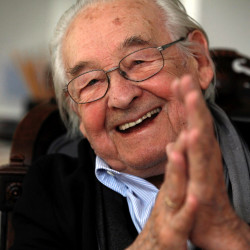 Oscar-winning Polish film director Andrzej Wajda smiles as he speaks to Reuters during an interview at Akson Studio office in Warsaw, Aug. 13, 2013.