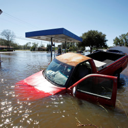 An abandoned truck lies in submerged waters after Hurricane Matthew hit Lumberton, North Carolina, on Sunday.