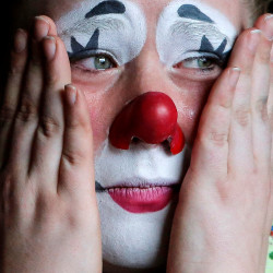 A circus clown cries as she watches the performing elephants prepare for their final show for the Ringling Bros and Barnum & Bailey Circus in Wilkes-Barre, Pennsylvania, in this May 2016 file photo.