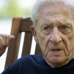 """Donn Fendler reflects on the 75th anniversary of his being """"Lost on a Mountain in Maine"""" in July 2014 at his camp in Newport."""