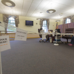 Ballot clerks pass time at Ellsworth City Hall waiting for voters to show up in this June 2015 file photo.