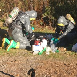 Agents with the Maine Drug Enforcement Agency sort through evidence seized Tuesday at a suspected methamphetamine lab on Route 1A in Fort Fairfield.