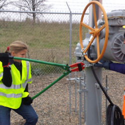 Activists are seen attempting to cut chains after trespassing into a valve station for pipelines carrying crude from Canadian oils sands into U.S. markets near Clearbrook, Minnesota.