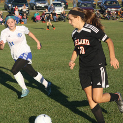 Ashland junior Mackenzie Carter (right) dribbles the ball in on Central Aroostook's Jessica Thomas during their soccer game on Tuesday in Mars Hill.