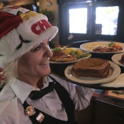 A waitress delivers breakfast at Peppertree Cafe in Glendora, California, Dec. 19, 2013.