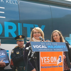 Gabrielle Giffords (center), a former Arizona congresswoman who recovered after being shot in the head in 2011, spoke about supporting a ballot measure that would extend background checks to private gun sales on Wednesday in Portland.