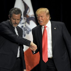 U.S. Republican presidential candidate Donald Trump (right) shakes hands with co-headliner Jerry Falwell Jr., leader of the nation's largest Christian university, during a campaign event at the Orpheum Theatre in Sioux City, Iowa, Jan. 31, 2016.