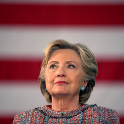 U.S. Democratic presidential nominee Hillary Clinton listens to former Vice President Al Gore talk about climate change at a rally at Miami Dade College in Miami, Florida, Oct. 11, 2016.