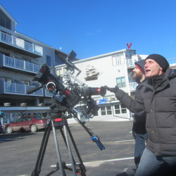 "Cameraman Glen Mordeci (foreground) and assistant cameraman Sam Bradley film exterior shots at the Trade Winds Motor Inn in Rockland, Feb. 26, 2016. The Trade Winds will be featured in an upcoming segment of the Travel Channel show ""Hotel Impossible."""