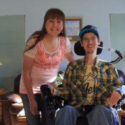 Mother and son Cheryl Morris and Adam MacDonald in their Presque Isle home. MacDonald, who turns 31 on Oct. 20, is thought to be the oldest Mainer alive with Duchenne muscular dystrophy.