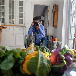 Fine art photographer Lynn Karlin photographs a still life of vegetables Friday in the small corner studio of her kitchen at her home in Belfast.