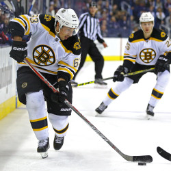 Boston's Brad Marchand (63) scores a goal on a shot against the Columbus Blue Jackets in the third period of Thursday's game at Nationwide Arena in Columbus, Ohio. The Bruins won 6-3.