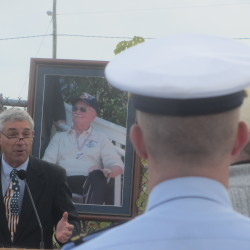 "Retired Coast Guard Chief Warrant Officer Paul Dilger addresses a gathering Thursday for the renaming of Tillson Avenue in Rockland on behalf of the Coast Guard and the late Ken Black who was known as ""Mr. Lighthouse."""