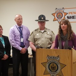 The family of Amy, Coty and Monica Lake who were killed by Steven Lake in a domestic violence murder-suicide in June of 2011 donated $10,000 to the Penobscot County Sheriff's Office to help pay for some of the immediate needs of people trying to escape abusive environments. From left are Marcie Ouellette, a victim-witness advocate who works for the Penobscot County District Attorney's Office, Chief Deputy William Sheehan, Sheriff Troy Mortin and Candace Sabo of the Spruce Run-Womancare Alliance, which assists people affected by domestic violence in Penobscot and Piscataquis counties.